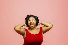 Loving It! /Portrait Of An Extremely Excited Woman Looking Up With Both Hands Behind Head