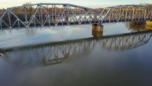 Aerial Shot Rising Above And Flying Over The Centennial Bridge In Sacramento California