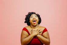 In Great Awe/Portrait Of An Extremely Excited Woman Looking Up With Both Hands Behind Head