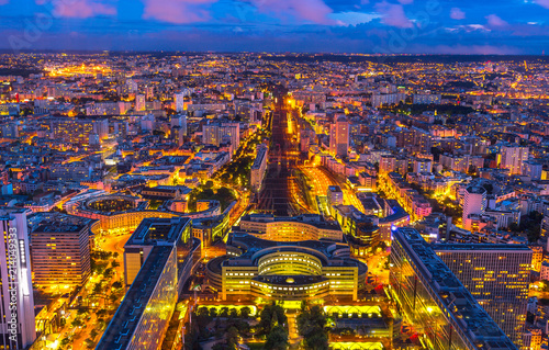 Photo sur Toile Europe Centrale Aerial view of Gare Montparnasse illuminated by blue hour from panoramic Tour Montparnasse. Paris urban cityscape. Parisian style architecture of France in Europe. Night scene.