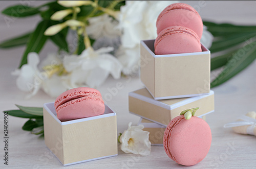 Keuken foto achterwand Macarons Pink rasberry macarons in the gift box on wooden background. French dessert macaroons and white flowers for best present or surprise.