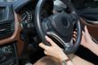 A women driving a car.