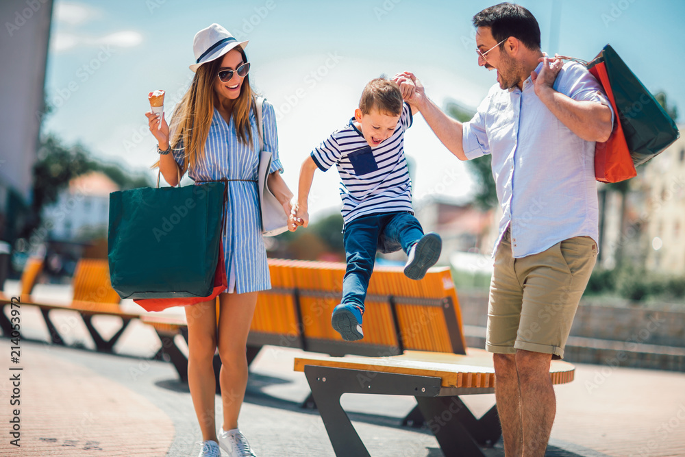 Fototapety, obrazy: Happy family having fun outdoor after shopping