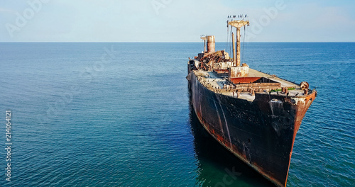 Foto op Canvas Schipbreuk Aerial Drone View Of Old Shipwreck Ghost Ship Vessel
