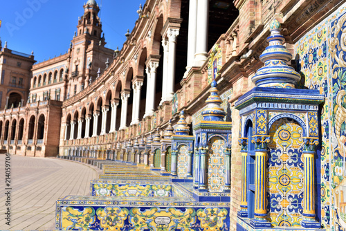 Poster Artistique Colourful tiles depicting scenes from different regions of Spain in Plaza de Espana in Seville, Spain
