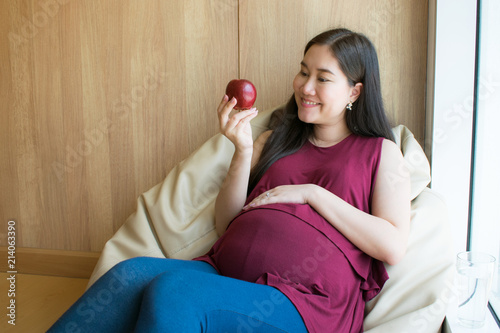 Stupendous Pregnancy And Healthy Eating Concept Pregnant Woman Holding Beatyapartments Chair Design Images Beatyapartmentscom
