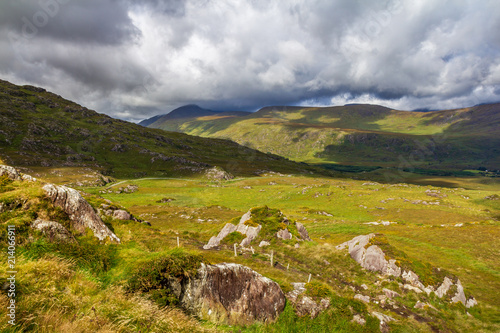 Foto op Canvas Bleke violet Typical green landscape from Ireland. Amazing picturesque view of wonderful nature. Rocks, stones, mountains, cloudy sky, colorful. Very popular travel destination. Travel, explore, discover, enjoy.