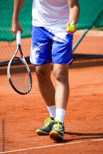 Tennisspieler Beine, Schläger, Aufschlag