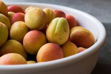 Raw Ripe Organic Orange Pile Of Apricots In Big Bowl.
