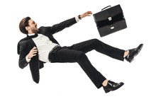 Shouting Young Businessman Falling With Briefcase Isolated On White