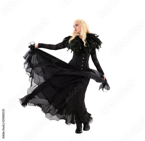 full length portrait of blonde girl wearing corset and long black gown Canvas