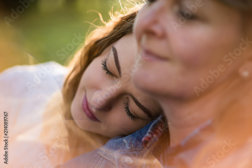 Senior mother with her teen daughter being together