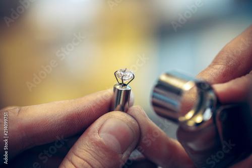 fototapeta na szkło Different goldsmiths tools on the jewelry workplace. Jeweler at work in jewelry.