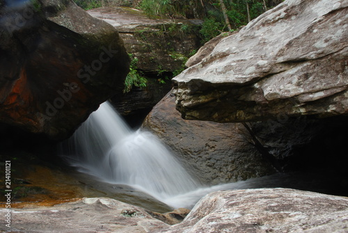 Poster Watervallen Waterfall with canyon in stones in Brazil