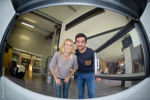 Fotografie, Obraz  Fisheye view of couple from inside a woodburner