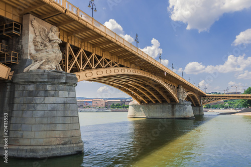 Spoed Foto op Canvas Brug Hercules with the wings sculpture on the piller of the unusual geometry yellow Margaret bridge (1876) connecting Buda and Pest across the Danube in Budapest Hungary