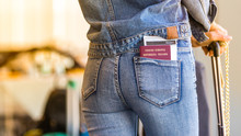 A Young Independent Woman (alone) Is Waiting For Her Departure With A Passport And Boarding Pass In The Back Pocket / Photo Of Nice Slim Fit Girl From Behind