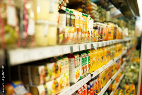 Fotografía  Shelves with different grocery products in the supermarket
