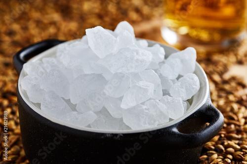 Vászonkép The original Belgian candied white sugar in a clay pot