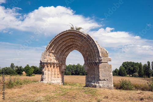 Ruined medieval arch of San Miguel de Mazarreros, in Olmillos de Sasamon. Burgos, Spain.