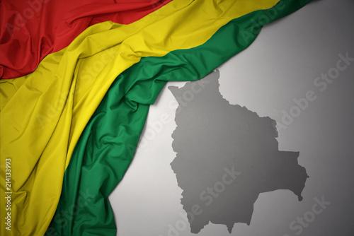 waving colorful national flag and map of bolivia. Wallpaper Mural