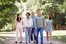 People, Friendship And International Concept - Group Of Happy Friends Walking In Park
