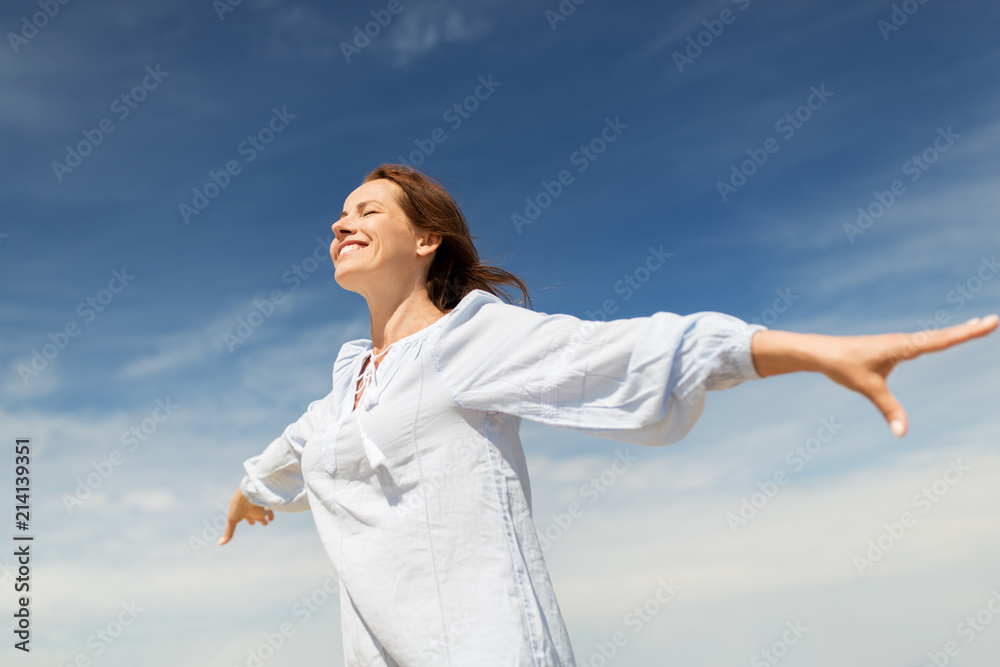 Fototapeta people and leisure concept - happy smiling woman enjoying summer