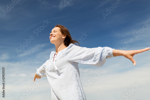 Obraz people and leisure concept - happy smiling woman enjoying summer - fototapety do salonu