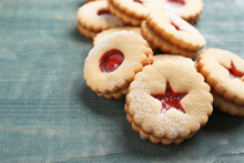Traditional Christmas Linzer Cookies With Sweet Jam On Wooden Background