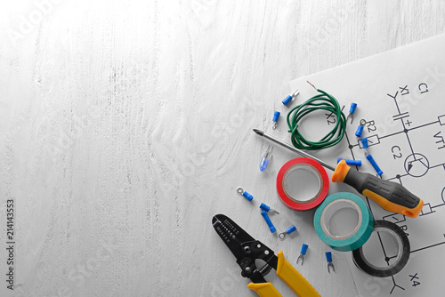 Fotografía Electrician's supplies with circuit diagram on light background