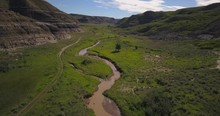4K Green Valley And Stream In Drumheller, Alberta, Canada - Daytime, Aerial, Low Elevation, Revealing Shot
