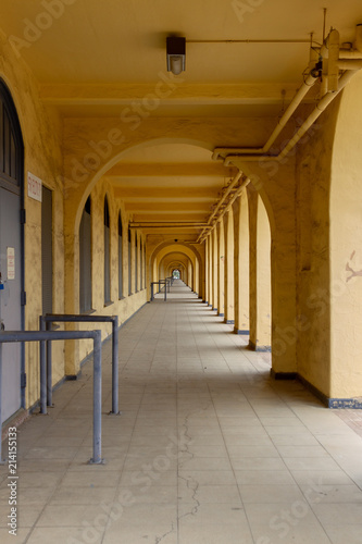 Fotografie, Obraz  A Long Glowing Yellow Colonnade