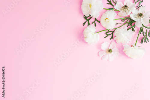 Tuinposter Magnolia White flowers and petals on pink pastel background. Flat lay, top view. Floral pattern
