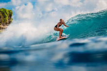 Surfer Girl On Wave In Ocean