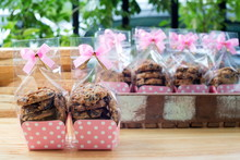 Cookie In Plastic Bag On Wooden Background With Ribbon Bow Tie,Cookie Packaging In Paper Cup.