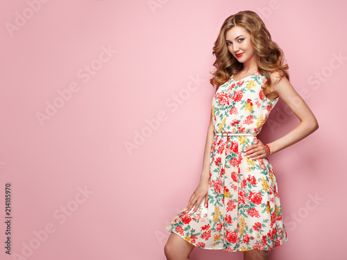 Blonde young woman in floral spring summer dress Fototapeta