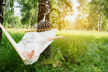 Woman Resting In Hammock. Sleeping Outdoors.