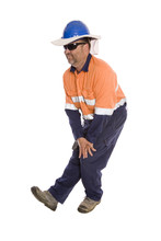 An Industrial Worker Doing Pre-start Stretching As A Safety Initiative.