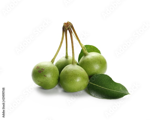 Wild, young green pears with twig and leaves isolated on white background