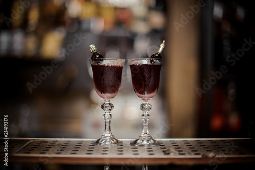 Two elegant glasses filled with fresh sweet and strong summer Arnaud cocktail Wallpaper Mural