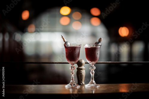 Two elegant glasses filled with fresh sweet and strong summer Arnaud cocktail on Tapéta, Fotótapéta