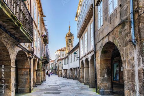 Leinwand Poster Narrow street in old town Santiago de Compostela, Galicia, Spain.