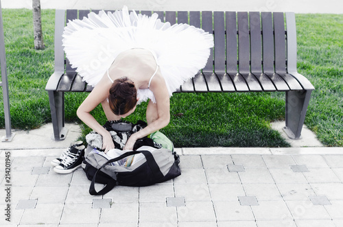 Ballerina sitting on bench in nature Wallpaper Mural