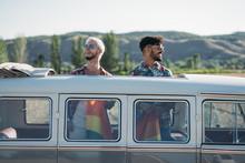 Gay Couple In Van Holding LGBT Flag
