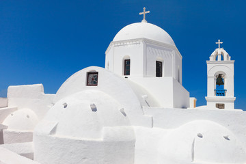 Greece, typical white church on the blue sky of Megalochori, Santorini
