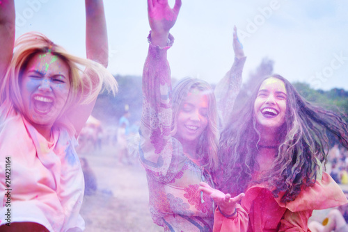 Crazy friends having fun with holi powder