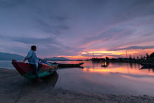 Sunset On Lap An Lagoon And Lang Co Bay With Colorful Clouds And A Man Looking Away. Lang Co Bay Is One Of The Most Famous And Beautiful Bays Of The World. HUE - VIETNAM Date 29/04/2018