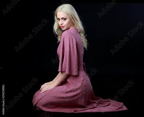 Fotomural full length portrait of blonde girl wearing long purple dress