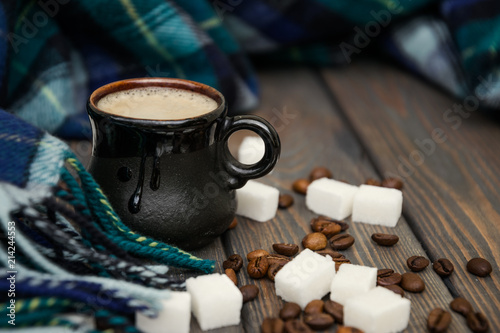 Foto op Canvas Cafe Hot aromatic coffee and a warm plaid