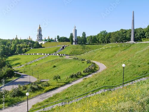 Foto op Plexiglas Kiev A green slope with woven sidewalks for descent near the Cathedral of St. Sophia of Kiev
